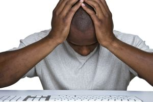 Discouraged man sitting in front of a computer