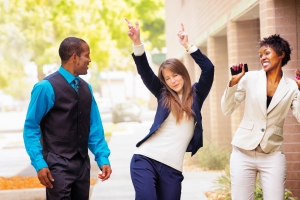 Office worker team does victory dance after receiving good news