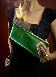 Woman holding pocketbook with money on fire