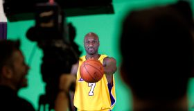 Lamar Odom, forward, for the Los Angeles Lakers, palms a basketball while being videotaped during L