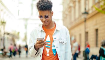 Young man using phone in the city