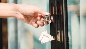 Landlord unlocks the house key for new house